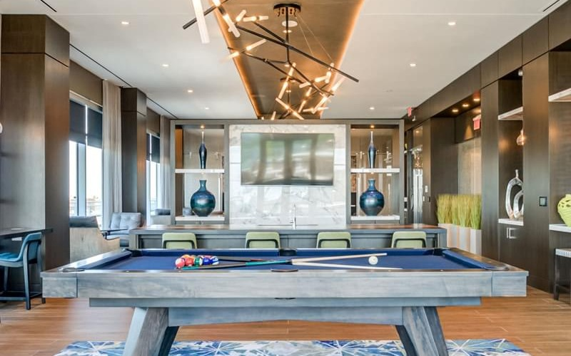 billiards table in well lit rooftop lounge